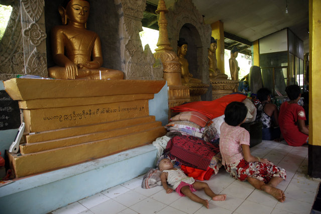 Flood victims gather inside a monastery, opened as a temporary relief camp, in Myauk U, Rakhine State, western Myanmar, Tuesday, August 4, 2015. (Photo by Khin Maung Win/AP Photo)