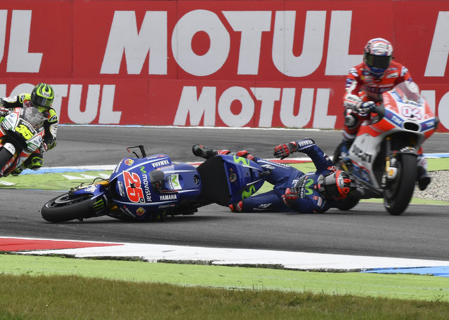 Moto GP rider Andrea Dovizioso of Italy, right, avoids running over Maverick Vinales of Spain after he crashed during the Dutch Motorcycle Grand Prix, in Assen, Northern Netherlands, Sunday, June 25, 2017. (Photo by Geert Vanden Wijngaert/AP Photo)