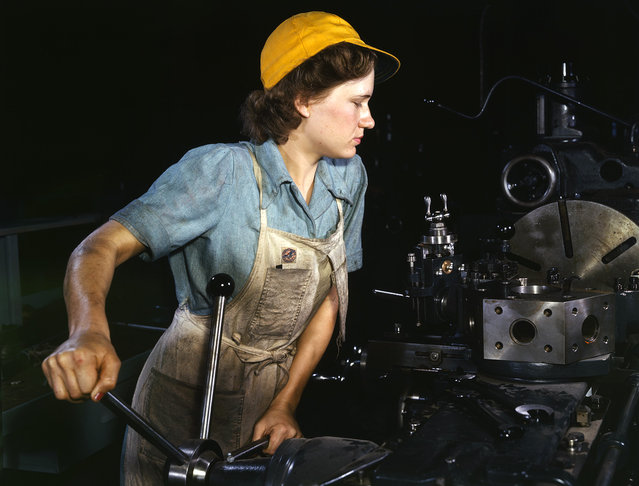 Lathe operator machining parts for transport planes at the Consolidated Aircraft Corporation plant, Fort Worth, Texas, October, 1942