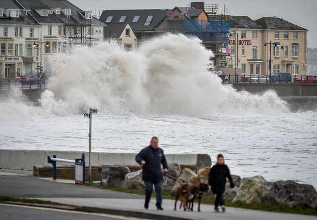 Huge waves hit the sea wall in Porthcawl, Wales on January 14, 2020, as gales of up to 80mph from Storm Brendan caused disruption around the UK. (Photo by Ben Birchall/PA Images via Getty Images)