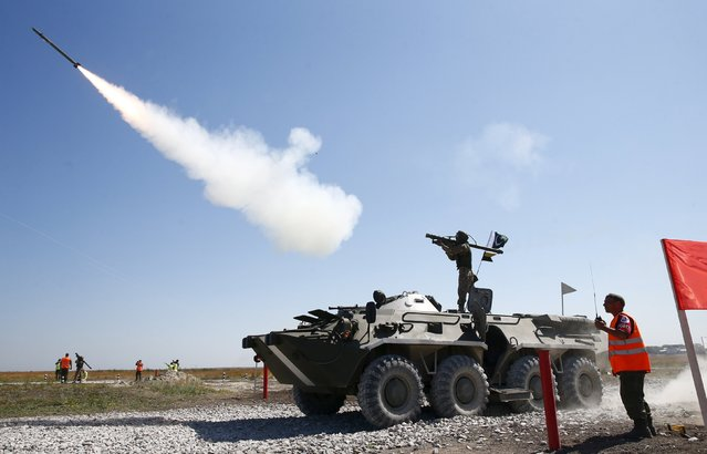 A serviceman from Pakistan is watched by a referee as he fires an anti-aircraft missile with the Russian-made Igla ground-to-air launcher during the Air defense battle masters competition as part of the International Army Games 2015 in the port town of Yeysk, Russia, August 9, 2015. (Photo by Maxim Zmeyev/Reuters)