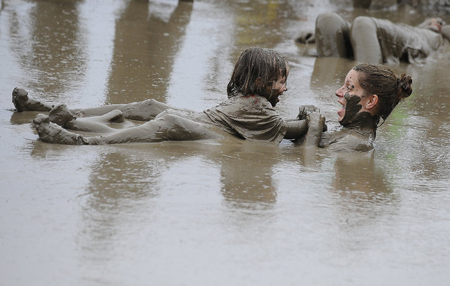 Jody Thomas and her 3-year old daughter, Kailyn Thomas, float around in the mud pit at the annual Wayne County Parks Mud Day at Hines Park- Nankin Mills Area, in Westland, Mich., on Tuesday, July 8, 2014, Kailyn's birthday. (Photo by Daniel Mears/AP Photo/The Detroit News)