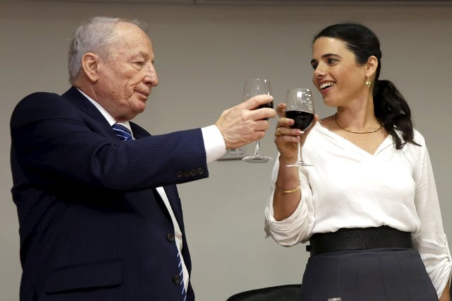 Ayelet Shaked (R), Israel's new Justice Minister of the far-right Jewish Home party, toasts with Attorney-General Yehuda Weinstein during a ceremony at the Justice Ministry in Jerusalem May 17, 2015. (Photo by Gali Tibbon/Reuters)