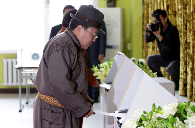 Mongolian President Tsakhiagiin Elbegdorj votes for the parliamentary elections at a polling station in downtown Ulaanbaatar, Mongolia, June 29, 2016. (Photo by Jason Lee/Reuters)