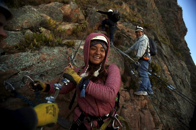A guest smiles as she leaves the Skylodge Adventure Suites in the Sacred Valley in Cuzco, Peru, August 14, 2015. (Photo by Pilar Olivares/Reuters)