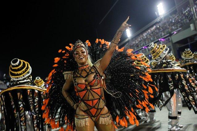 A reveller of Estacio de Sa samba school performs during the first night of the Carnival parade at the Sambadrome in Rio de Janeiro, Brazil on February 23, 2020. (Photo by Ricardo Moraes/Reuters)