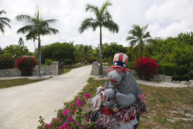 A mailbox in the shape of a manatee decorated with American flags and lipstick is seen along the highway US-1 in the Lower Keys near Tavernier in Florida, July 10, 2014. (Photo by Wolfgang Rattay/Reuters)