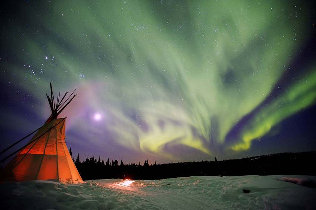 Honorable Mention, Environment (Nature, Wildlife). Photo by Jay Capers of Randolph Community College: The Northern Lights dance over a teepee in Yellowknife, NWT, Canada. (Photo by Jay Capers)