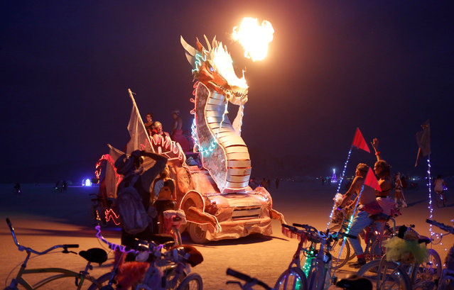 Participants ride a mutant vehicle as approximately 70,000 people from all over the world gathered for the annual Burning Man arts and music festival in the Black Rock Desert of Nevada, U.S. on  on August 31, 2017. (Photo by Jim Urquhart/Reuters)