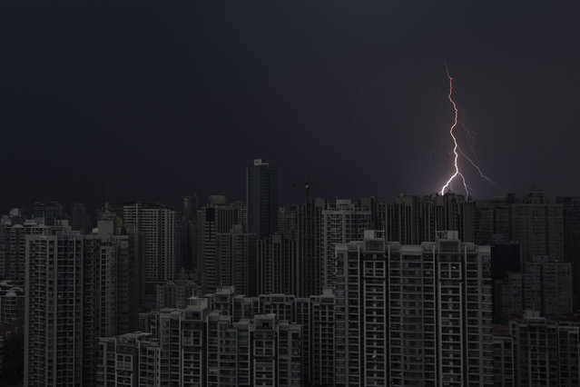 Lightning is seen above buildings during a storm in central Shanghai August 15, 2012. (Photo by Aly Song/Reuters)