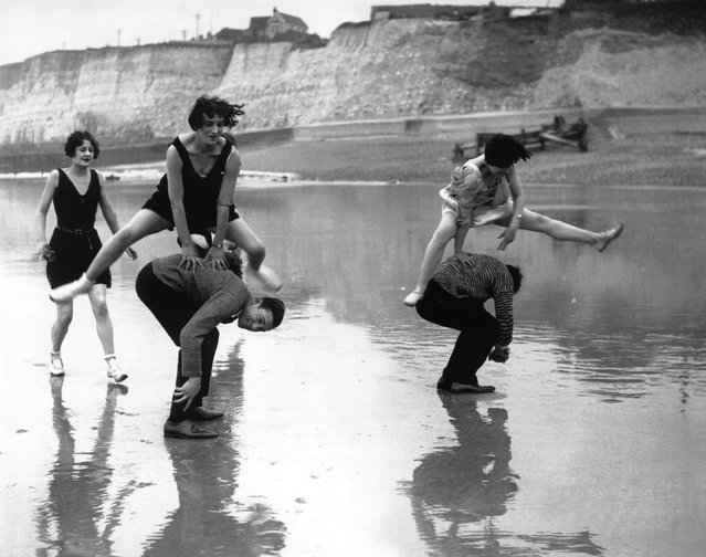 Members of the Brighton Swimming Club leap-frogging on the beach at Brighton, 1925. (Photo by E. Bacon)