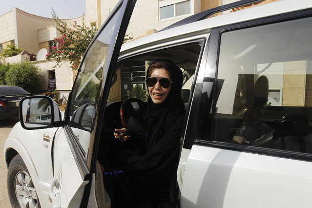 Female driver Azza Al Shmasani alights from her car after driving in defiance of the ban in Riyadh, June 22, 2011. (Photo by Fahad Shadeed/Reuters)