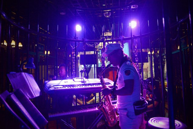 This picture taken on September 9, 2014 shows a musician performing at a prison themed restaurant in Tianjin. (Photo by Wang Zhao/AFP Photo)
