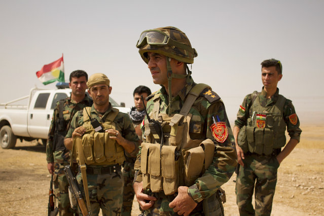 Lt. Col. Arshad Hussein with the 1st Zerevani Brigade at a small outpost outside the village of Qarqashah, Iraq in Monday, August 15, 2016. (Photo by Susannah George/AP Photo)
