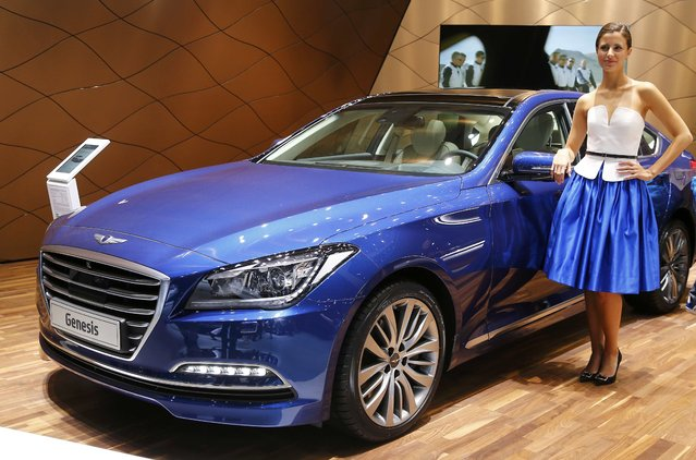 A model poses with the Hyundai Genesis car during the media day at the Frankfurt Motor Show (IAA) in Frankfurt, Germany, September 15, 2015. (Photo by Kai Pfaffenbach/Reuters)