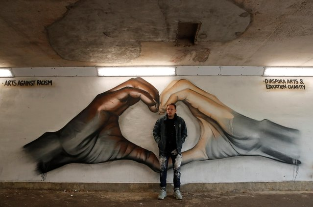 Street artist Nathan Murdoch poses with his art against racism mural in a tunnel in Peterborough, following the death of George Floyd who died in police custody in Minneapolis, Peterborough, Britain, June 10, 2020. (Photo by Andrew Couldridge/Reuters)