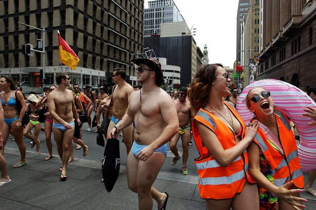"""Sydneysiders take part in the """"AIME Strut the Streets"""" in an attempt to break the Guiness record for the world's largest swimwear parade on December 7, 2012 in Sydney, Australia. The event was organised to raise funds and awareness for the not for profit charity organisation, the Australian Indigenous Mentoring Experience.  (Photo by Lisa Maree Williams)"""