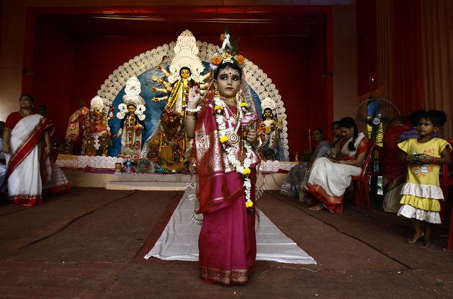 Mahaswata Roy Chowdhury, a five-year old girl dressed as a Kumari, poses during the religious festival of Durga Puja in Kolkata October 2, 2014. Kumari is a young virgin girl who is worshipped as part of the Durga Puja rituals. (Photo by Rupak De Chowdhuri/Reuters)