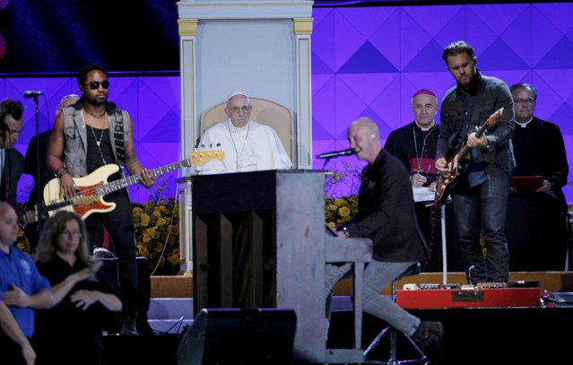 Pope Francis (rear) listens to rock group The Fray as he attends the Festival of Families rally in Philadelphia, Pennsylvania September 26, 2015. (Photo by Brian Snyder/Reuters)