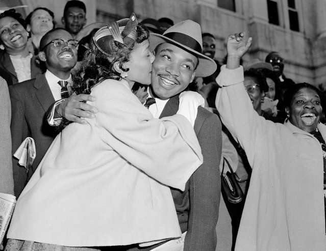 The Rev. Martin Luther King Jr. is welcomed with a kiss by his wife Coretta after leaving court in Montgomery, Ala., March 22, 1956. King was found guilty of conspiracy to boycott city buses in a campaign to desegregate the bus system, but a judge suspended his $500 fine pending appeal. (Photo by Gene Herrick/AP Photo)
