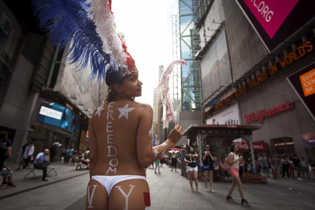 Saira Nicole, who poses for tips wearing body paint and underwear, poses for a portrait in Times Square in New York in this August 19, 2015 file photo. (Photo by Carlo Allegri/Reuters)
