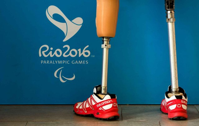 Athlete wears prosthetic legs at the Paralympic Village during the Paralympic Games in Rio de Janeiro, Brazil, on September 6, 2016. (Photo by Al Tielemans/OIS/IOC via AFP Photo)