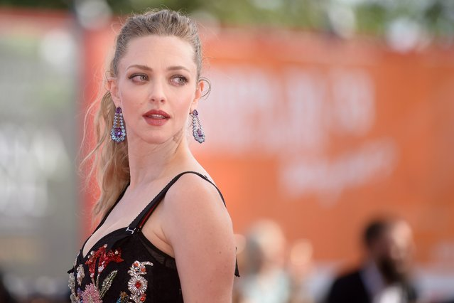 "Actress Amanda Seyfried arrives for the premiere of the movie ""First Reformed"" presented in competition at the 74th Venice Film Festival on August 31, 2017 at Venice Lido. (Photo by Filippo Monteforte/AFP Photo)"