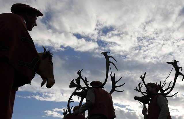 Dancers perform the Abbots Bromley Horn Dance in Abbots Bromley, Britain, September 12, 2016. (Photo by Darren Staples/Reuters)