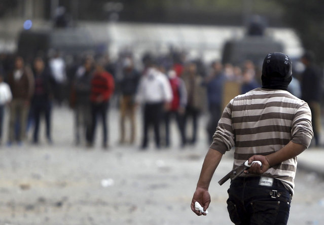 A protester opposing Egyptian President Mohamed Morsi holds a homemade gun during clashes with riot police, along Qasr Al Nil bridge, in Cairo, on January 27, 2013. (Photo by Amr Abdallah Dalsh/Reuters/The Atlantic)