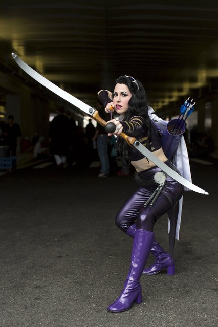 Minnie D'moocha poses as Kate Bishop Hawkeye on day two of New York Comic Con in Manhattan, New York, October 9, 2015. (Photo by Andrew Kelly/Reuters)