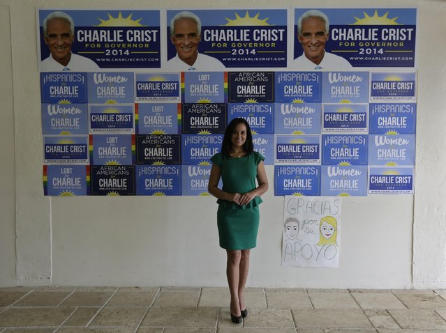 Former Cuban rafter Gricel Gonzalez, 37, poses at the campaign headquarters of Democratic candidate for the governor of Florida, Charlie Crist, where she works as a communications director in Miami, September 14, 2014. Gonzalez was 16 when she boarded a boat in Cuba with her sister, mother and stepfather to try and reach the Guantanamo Base during the 1994 Cuban Exodus. She said that at night they heard a man crying for help for a pregnant woman, but they never saw them. (Photo by Rolando Pujol Rodriguez/Reuters)