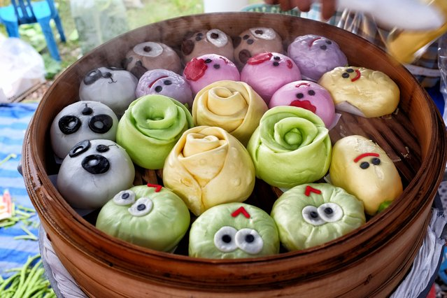 Steamed Chinese-style buns, known locally as salapao, are decorated with faces during the start of the annual 10-day vegetarian festival in Bang Saphan, southern Thailand on October 13, 2015. (Photo by Matthew Richards/Courtesy Image)