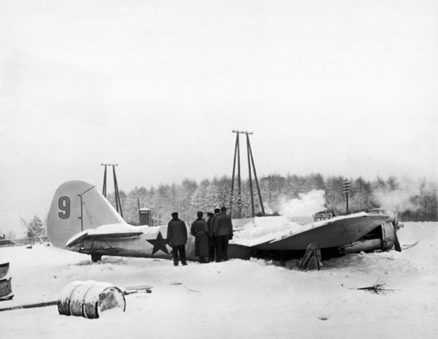 Soviet bomber, shot down by Finnish anti-aircraft guns on the Karelian front, where Russia was reporting on January 3, 1940 massing seven divisions for a drive on the Mannerheim Line. (Photo by AP Photo)