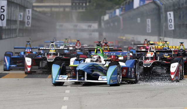 Drivers leave the starting grid during the Formula E Championship race in Putrajaya November 22, 2014. The FIA Formula E Championship is the world's first fully electric racing series. (Photo by Olivia Harris/Reuters)