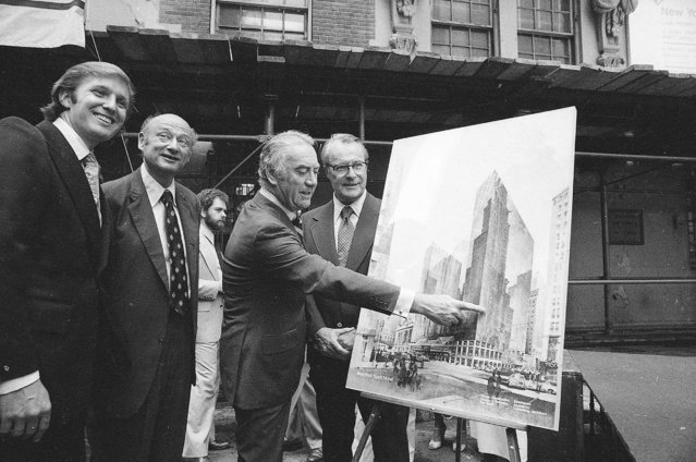 Governor Hugh Carey points to an artists' conception of the new New York Hyatt Hotel/Convention facility that will be build on the site of the former Commordore Hotel, June 28, 1978. At the launching ceremony are, from left:  Donald Trump, son of the city developer Fred C. Trump; Mayor Ed Koch of New York; Carey; and Robert T. Dormer, executive vice president of the Urban Development Corp. (Photo by AP Photo)
