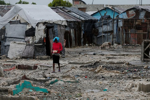A woman walks next to makeshift houses while Hurricane Matthew approaches in Port-au-Prince, Haiti October 3, 2016. (Photo by Carlos Garcia Rawlins/Reuters)