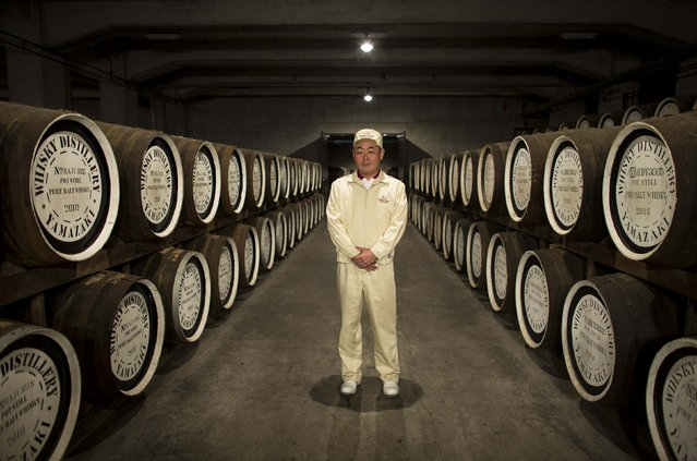 Senior General Manager of Suntory Holdings' Yamazaki Distillery Takahisa Fujii poses in the distillery's cask storage in Shimamoto town, Osaka prefecture, near Kyoto, December 1, 2014. (Photo by Thomas Peter/Reuters)