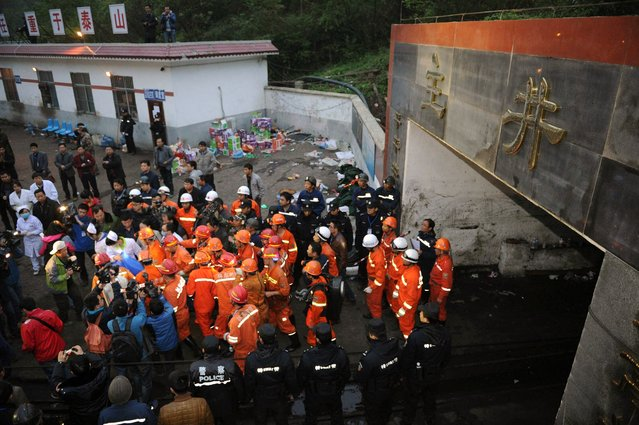 A rescued miner is carried out of the mine shaft of a flooded coal mine in Weng'an County, southwest China's Guizhou Province, Monday, April 8, 2013. Chinese state media Xinhua News Agency say three miners have been rescued after spending two and a half days trapped underground because of flooding in the coal mine that killed three of their colleagues. (Photo by Liu Xu/AP Photo/Xinhua)