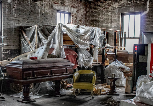 "Urban Explorer Abandoned Southeast says, ""It is unusual, but that's what I enjoyed most about it – the amount of things left behind. Old coffins on shelves, glassware used for embalming, early 1900s photographs of people, probably left over from funerals"". (Photo by Abandoned Southeast/Caters News Agency)"