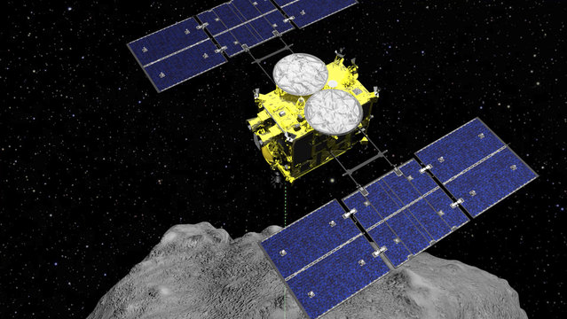 This computer graphics image released by the Japan Aerospace Exploration Agency (JAXA) shows the Hayabusa2 spacecraft above the asteroid Ryugu. The Japanese space agency said Friday they are all set for the spacecraft′s final approach to Earth this weekend to deliver a capsule containing valuable samples of a distant asteroid that could provide clues to the origin of the solar system. (Photo by ISAS/JAXA via AP Photo/File)
