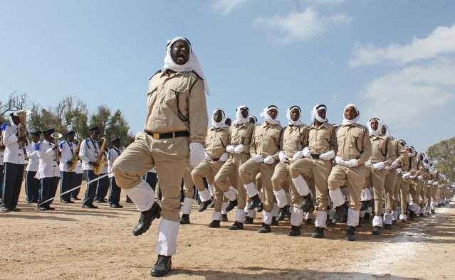 Somali police march at police academy compound during  their 71st anniversary in Mogadishu, Somalia, Saturday, December 20, 2014. (Photo by Farah Abdi Warsameh/AP Photo)