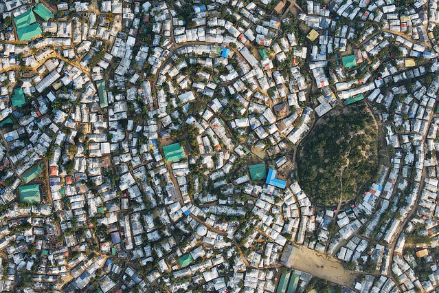 In this aerial picture taken on December 4, 2020, the Kutupalong camp for Rohingya refugees is pictured in Ukhia, Bangladesh. (Photo by AFP Photo/Stringer)