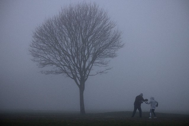 A boxing training session in the fog on Bromley Common on November 27, 2020 in Bromley, England. The Met Office issued a yellow weather warning for the UK today for freezing fog patches. (Photo by Dan Kitwood/Getty Images)