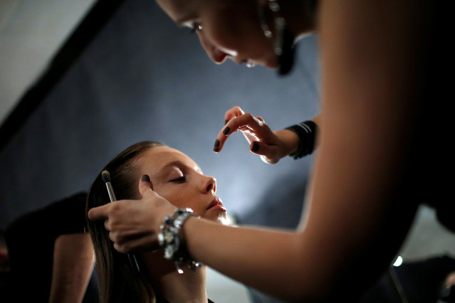 A model has make-up applied backstage at the Tbilisi Fashion Week in Tbilisi, Georgia, October 20, 2016. (Photo by David Mdzinarishvili/Reuters)