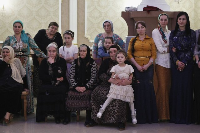 Women watch dancing at a wedding party in the Chechen capital Grozny April 24, 2013