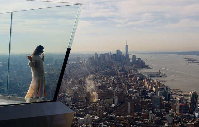 A person stands next to the skyline of lower Manhattan on the opening day the Edge NYC, an outdoor observation deck on the 100th floor of 30 Hudson Yards on March 11, 2020 in New York City. (Photo by Gary Hershorn/Getty Images)