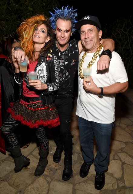 (L-R) Model Cindy Crawford, Casamigos co-founder Rande Gerber and Discovery Land Company CEO Mike Meldman attend the Casamigos Halloween Party at a private residence on October 28, 2016 in Beverly Hills, California. (Photo by Michael Kovac/Getty Images for Casamigos Tequila)