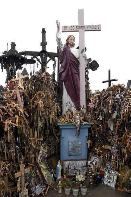 Shrines, pictures of saints, and other icons of faith decorate the area. (Photo by Richard Gardner/Rex USA)