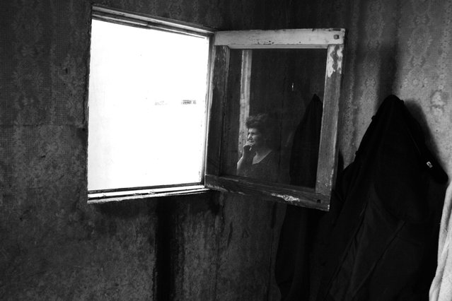 """Introspection"". I have always had a fascination with windows. The images they frame look different to each person, and what one chooses to see reflects their entire being – their emotions, their worries, their soul. In this remote village in the Lori region of Armenia, life has treated its subjects harshly, but a quick look out the window seems to provide an escape from life's many troubles. This photograph reminds me that sometimes we must look into the window of ourselves to understand this complicated world. Location: A remote village in the Lori region of Armenia. (Photo and caption by Nar Gulvartian/National Geographic Traveler Photo Contest)"