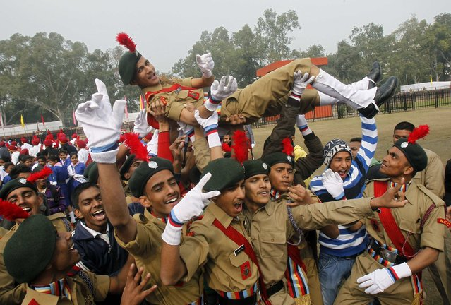 Cadets from the National Cadet Corps (NCC) celebrate after being awarded third position in the best marching trophy competition during the Republic Day celebrations in the northern Indian city of Chandigarh January 26, 2015. (Photo by Ajay Verma/Reuters)